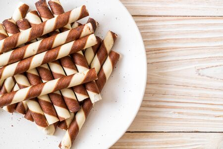 chocolate wafers stick roll on wood background