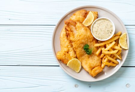 fish and chips with french fries - unhealthy food Banco de Imagens