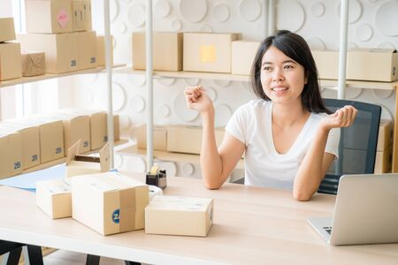 Young Women happy after new order from customer, business owner at home - online shopping SME entrepreneur or freelance working concept