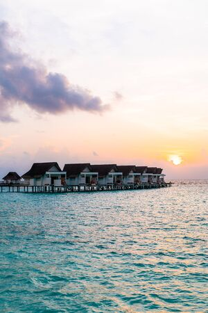 Beautiful tropical Maldives resort hotel and island with beach and sea  - vintage effect filter