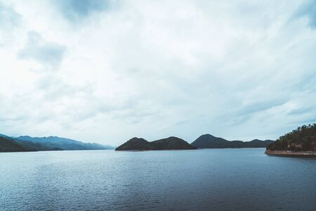 Nature scene of Srinagarind Dam with cloudy sky at kanchanaburi ,Thailand 写真素材