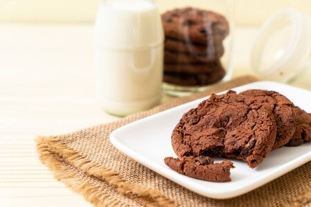 chocolate cookies with chocolate chips on wood background Stock Photo