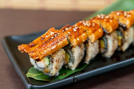 eel (unagi) sushi roll - japanese food style Stock Photo - 129882073