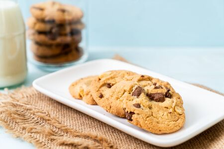 cookies with chocolate chips on wood background