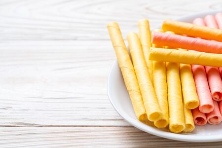 colorful wafer stick roll with cream Stok Fotoğraf