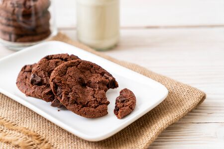 chocolate cookies with chocolate chips on wood background Stok Fotoğraf