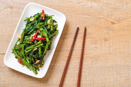 Stir-Fried Chinese Morning Glory or Water Spinach - Asian food style Stock fotó