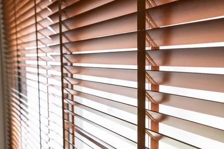 Wooden shutters blind on the window in the living room Reklamní fotografie
