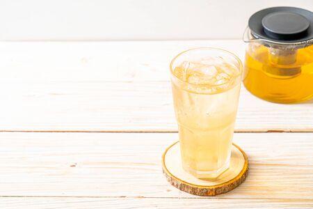 iced jasmine tea on wood background