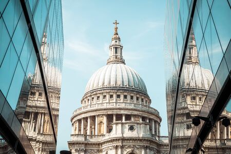 St. Paul's Cathedral church ireflected in glass walls of One New Change in London, United Kingdom. Stock Photo