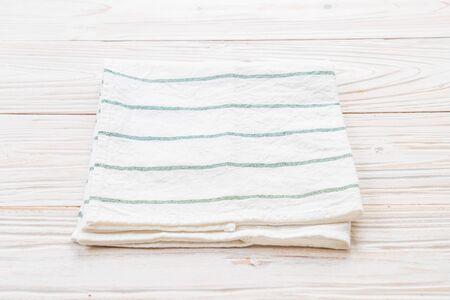 kitchen cloth (napkin) on wood background Stock Photo