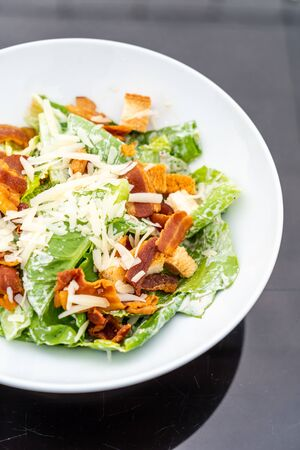 Caesar Salad on white plate - healthy food style