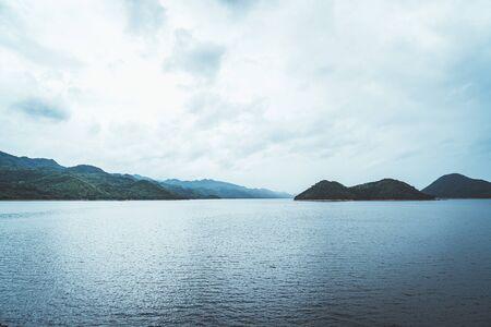 Nature scene of Srinagarind Dam with cloudy sky at kanchanaburi ,Thailand Stock Photo