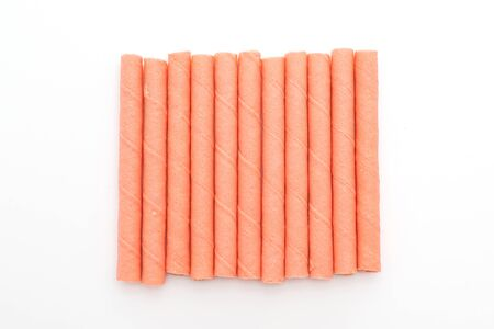 biscuits wafer stick with strawberry cream flavour isolated on white background