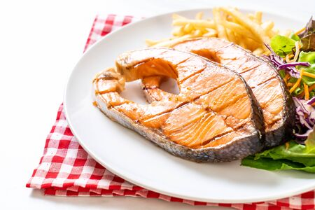 double grilled salmon steak fillet with french fries Stockfoto