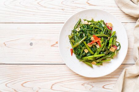 Stir-Fried Chinese Morning Glory or Water Spinach - Asian food style Stockfoto
