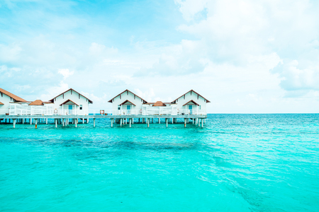 Beautiful tropical Maldives resort hotel and island with beach and sea  - boost up color processing style Editorial