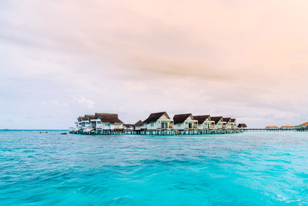 tropical Maldives resort hotel and island with beach and beautiful sky for holiday vacation concept Editorial