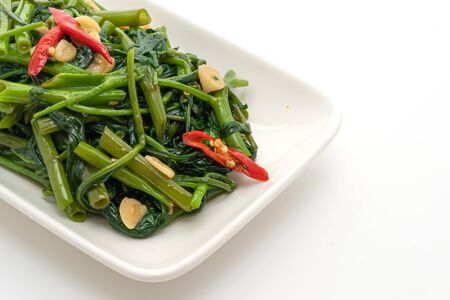 Stir-Fried Chinese Morning Glory or Water Spinach isolated on white background Reklamní fotografie