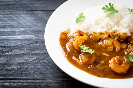 Shrimps in curry sauce on topped rice