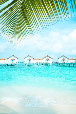 Beautiful tropical Maldives resort hotel and island with beach and sea  - boost up color processing style Banco de Imagens