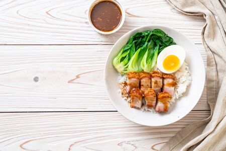 crispy pork belly on topped rice - Asian food style