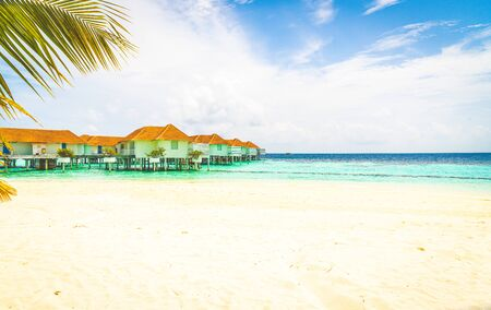 Beautiful tropical Maldives resort hotel and island with beach and sea - holiday vacation background concep Editorial