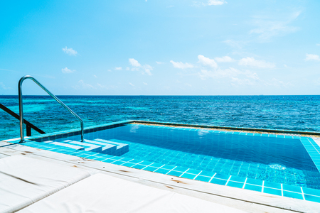 swimming pool with ocean and sea background in Maldives