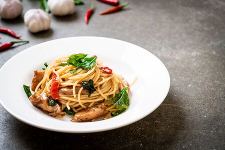 stir-fried spaghetti with chicken and basil - fusion food style Stock fotó