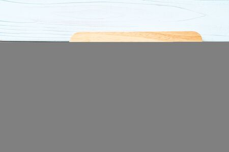 empty cutting wooden board with kitchen cloth on wood background