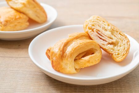 Homemade ham cheese croissant on white plate