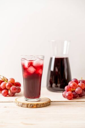 Fresh grape juice on wood
