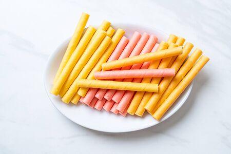 colorful wafer stick roll with cream Фото со стока