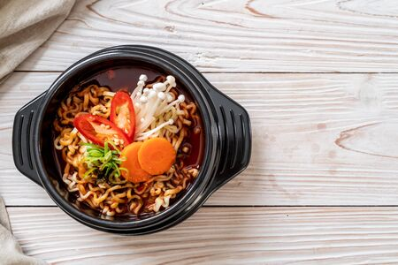 korean instant noodles in black bowl - korean food style Stock Photo