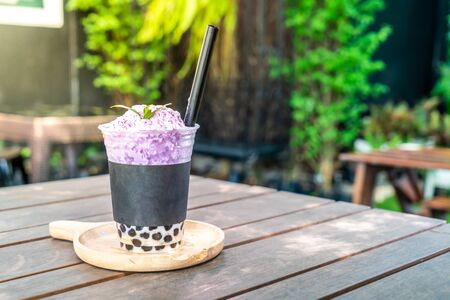 purple potatoes tea with bubble in cafe restaurant Stock Photo
