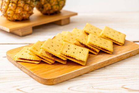 cheese biscuits with pineapple jam on wood background Reklamní fotografie - 135503372