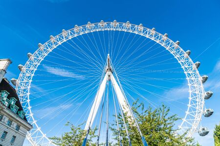 White Beautiful large Ferris wheel with blue sky background 写真素材