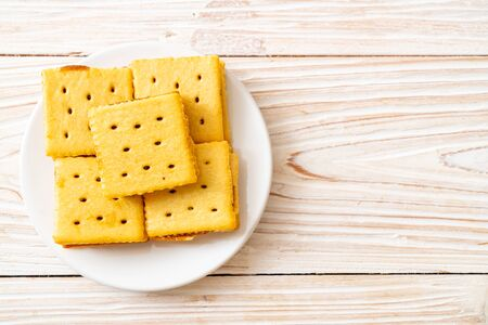 cheese biscuits with pineapple jam on wood background