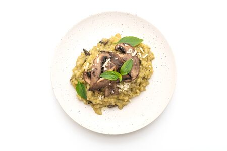 Mushroom Risotto with Pesto and Cheese isolated on white background
