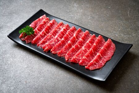 fresh beef raw sliced with marbled texture served for Sukiyaki and Shabu or Yakiniku Stock Photo
