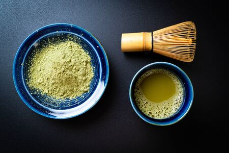 hot matcha green tea cup with green tea powder and bamboo whisk Stock fotó