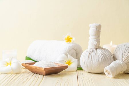 Spa herbal compressing ball with candle and orchid - beauty concept