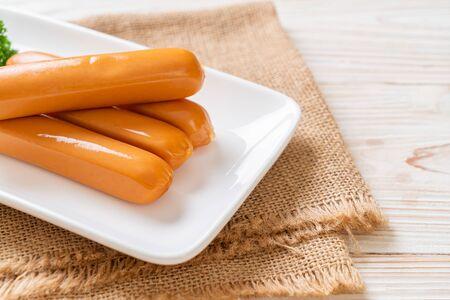 Chicken Frankfurt Sausage on white plate