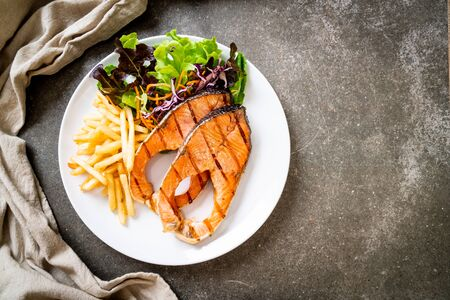double grilled salmon steak fillet with french fries Stock Photo