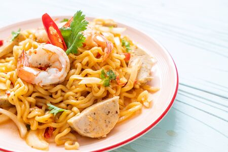 spicy instant noodles salad with shrimps - Thai food style 写真素材