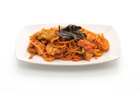 stir-fried noodles with Korean spicy sauce and vegetable isolated on white background 写真素材