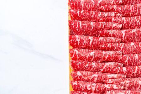fresh beef raw sliced with marbled texture served for Sukiyaki and Shabu or Yakiniku Stock Photo