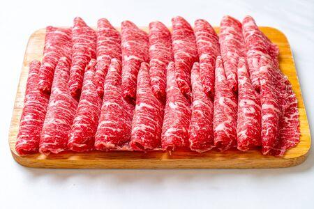 fresh beef raw sliced with marbled texture served for Sukiyaki and Shabu or Yakiniku Фото со стока