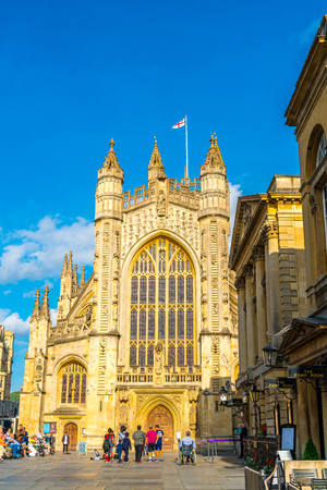 BATH, ENGLAND - AUG 30, 2019: Bath Abbey with tourist. It is an Anglican parish church and a former Benedictine monastery, founded in the 7th century.