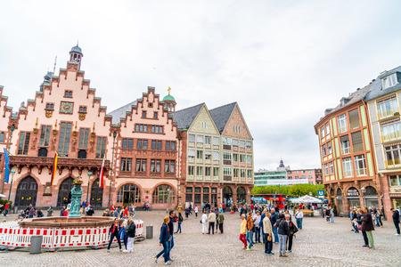 FRANKFURT, GERMANY - SEP 2, 2018: People on Roemerberg square in Frankfurt, Germany. Frankfurt is the fifth-largest city in Germany.